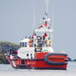 Coast Guard vessel monitoring fishing boat that ran aground near Sidney off Coal Island.