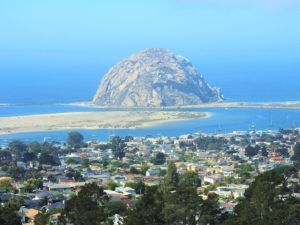 Mayaluga anchored in foreground in line with teh right face of Morro Rock.